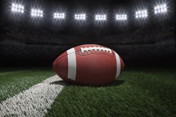 College style football on field with stripe under stadium lights