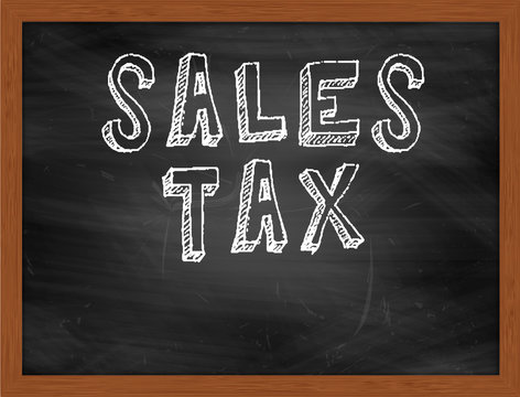 SALES TAX handwritten text on black chalkboard