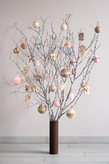 Christmas tree made from branches and vintage balls and decorati