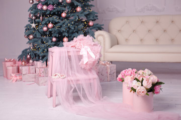 Christmas interior with Christmas tree in soft pink color