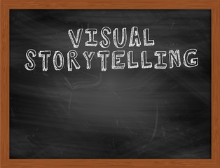VISUAL STORYTELLING handwritten text on black chalkboard