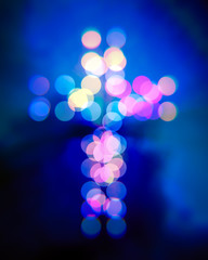 Christian cross bokeh, blurry light circles illustration