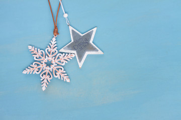 Blue and white christmas with stars on blue wooden background