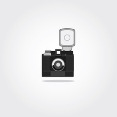 Photo camera icon in flat style. Vector Illustration