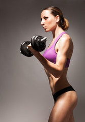 Profile view strong confident slim woman workout