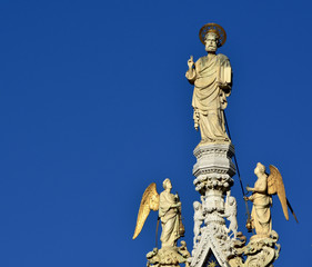 Saint Mark blessing with angels at the top of Venice Basilica (with copy space)