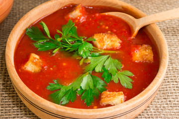 Gazpacho soup with croutons and herbs. National Spanish cuisine.