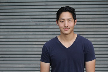 Asian Man Portrait Smiling Isolated with Copy Space for Text Available on the Side