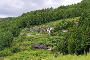 Japanese rural farm on mountain slopes