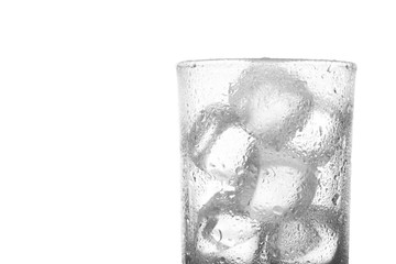 close up photo of empty glass with ice cubes isolate on white background with clipping path and copy space