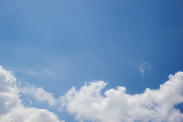 horizontal photo of clouds in blue sky with copyspace in the middle