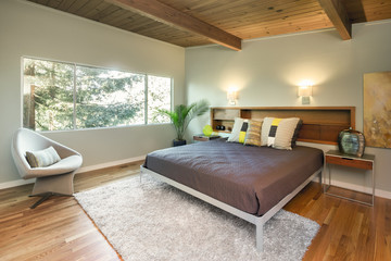 Mid Century Modern bedroom with wooden roof and wooden floor.