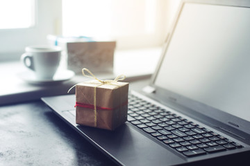 gift box and laptop, the concept of e-shopping