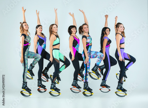 the group of girls jumping on kangoo training. Black Bedroom Furniture Sets. Home Design Ideas