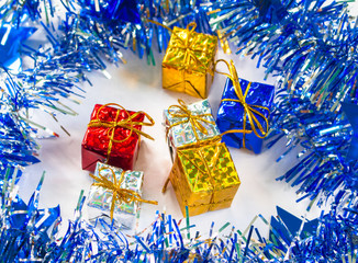Christmas gift in blue wreath with festive decor.