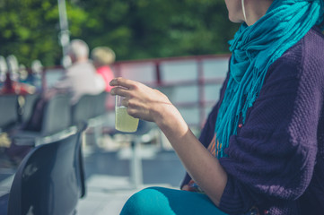 Woman drinking lemonade on a boat