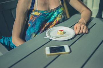 Woman with scone and phone