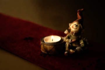 Christmas decoration, a candle with dwarf, ceramic figurine.