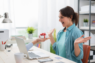 Woman receiving a gift from a website