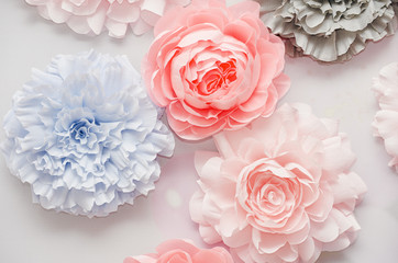 Decorative colorful paper flowers at the wedding ceremony