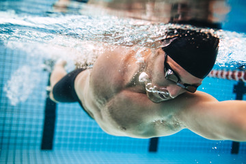 Male swimmer Under Water in Pool Wall mural
