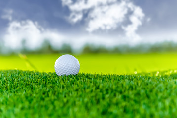 Golf ball on cloud sky background