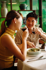 Couple dining in Chinese restaurant, drinking wine