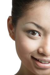 Young woman looking at camera, head shot