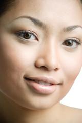 Young woman looking at camera, smiling