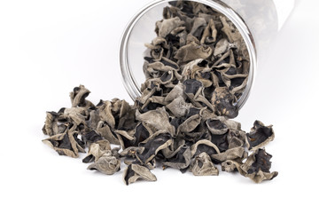 Dried chinese black fungus and container on the white