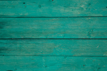 old horizontal boards covered in blue paint