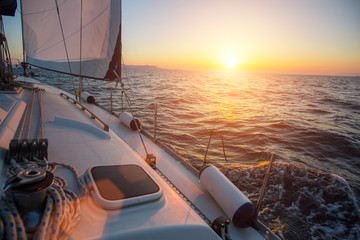 Sailing on the waves during a wonderful sunset. Travel. Luxery yacht.