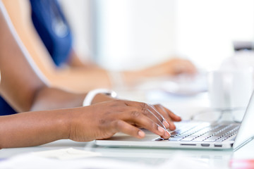 Image of woman's hands typing