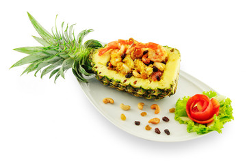 Thai rice with seafood in pineapple in white plate isolated