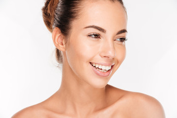 Beauty portrait of a happy woman with skincare