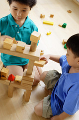 Children playing with building blocks, high angle view