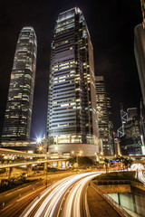Skyscrapers and highway in Hong Kong at night
