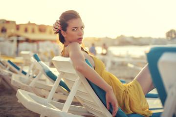 Woman sitting on a beach chair