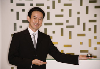 Businessman standing with arms outstretched, smiling