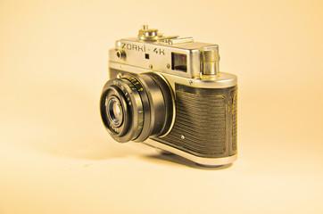 Old soviet rangefinder camera isolated on white background