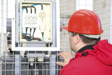 Electrician control high voltage fuse in power plant