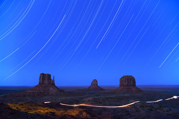 Star trails in the night in Monument Valley, USA