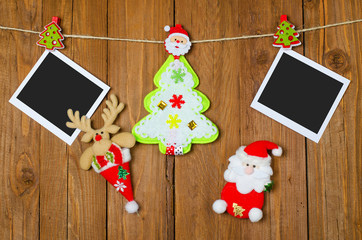 Christmas decorations and blank photo frames on the wooden backg