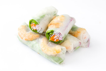 Vietnamese rolls with vegetables, rice noodles and prawns isolated on white background
