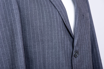 details on the  pinstripe suit coat
