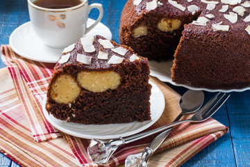 Homemade chocolate cake with curd-coconut balls