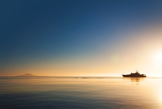 Silhouette of a luxurious yacht on the sea of cortez  at sunset