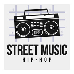 Black Boombox tape on a gray background with a grid and the words: street music and hip-hop. Vector Image. street art concept. Vintage. It can be used as graffiti, prints, posters, printed materials.