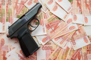 Black gun lies on the Russian big money