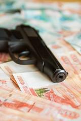 Black gun lies on the Russian big money